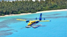 seaplane over lagoon & island
